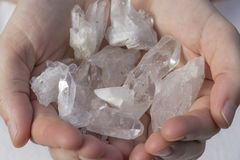 A hand holding a pile of quartz Stock Photo