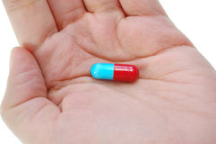 Hand holding a pill Stock Photography