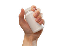 Hand Holding Pill Bottle. A hand is holding a blank, white pill bottle in the air Royalty Free Stock Images