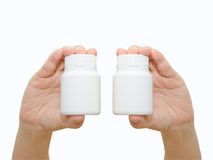 Hand holding a pill bottle Stock Photo