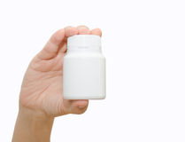 Hand holding a pill bottle Royalty Free Stock Photography