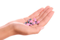 Hand holding pills Royalty Free Stock Photo
