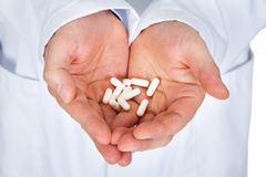 Hand Holding Pills Royalty Free Stock Images