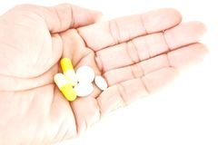 Hand holding pills Stock Photography