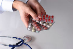 Hand holding a pills. Doctor Hand holding a pills Royalty Free Stock Photos