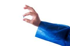 Hand holding pills Stock Photos