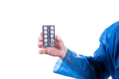 Hand holding pills Stock Image
