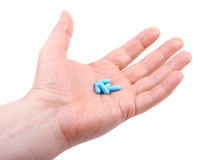 Hand holding  pills. on white Stock Images