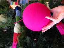 Hand holding pink Christmas ball Royalty Free Stock Image