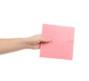 Hand holding pink cleaning sponge. Stock Photos