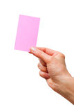 Hand holding a pink sheet of paper Stock Image