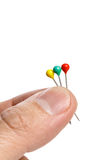 Hand holding pins Royalty Free Stock Images
