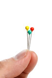 Hand holding pins Stock Photo