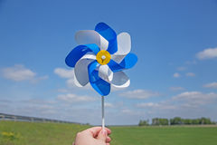 Hand holding pinwheel over horizon Stock Images