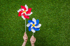Hand holding pinwheels over grass Stock Photography