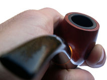 Hand holding pipe. Man hand holding a pipe for smoking royalty free stock photo