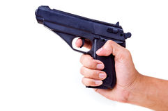 Hand holding pistol Royalty Free Stock Photography