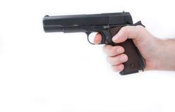 Hand holding pistol handgun isolated on white background Stock Photo