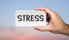 Hand holding placard with word `STRESS`. STRESS concept. royalty free stock images