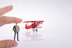Hand holding plane with a figure on it Stock Images