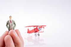 Hand holding plane with a figure on it Royalty Free Stock Photography
