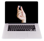 Hand Holding Planet Earth with fingers, on Laptop Monitor isolat Stock Image