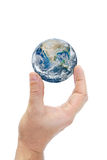 Hand holding planet earth isolated on white background. Royalty Free Stock Photo