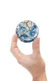 Hand holding planet earth isolated on white background Royalty Free Stock Photo
