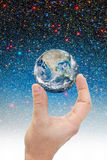 Hand holding planet earth in space. royalty free stock images