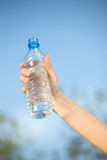 Hand holding plasic bottle of water Stock Photography