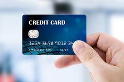 Hand holding plastic credit card Royalty Free Stock Image