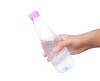 Hand holding plastic water bottle. Isolated on white background Stock Photo
