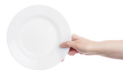 Hand holding plate Royalty Free Stock Photography