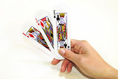 Hand holding playing cards Stock Photos