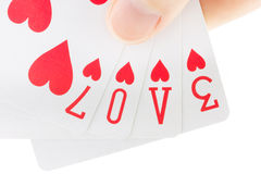 Hand holding playing cards spelling the word love Royalty Free Stock Image