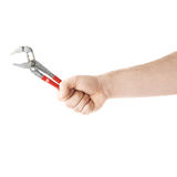 Hand holding a plumber wrench tool, composition isolated over the white background Stock Photo