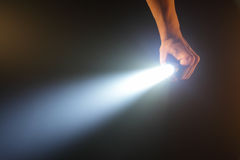 Hand holding pocket flashlight Royalty Free Stock Images