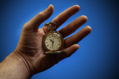 Hand holding pocket watch Royalty Free Stock Photos
