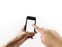 Hand holding and pointing on Smart Phone. Isolated on white royalty free stock image