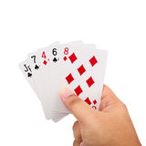 Hand holding a poker cards isolated on white background. Close up of man hand holding a poker cards isolated on white background with clipping path Royalty Free Stock Image