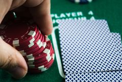 HAND HOLDING POKER CHIPS stock photos