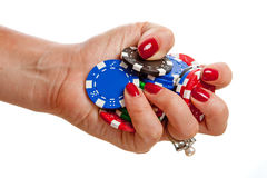 Hand holding poker chips Royalty Free Stock Image