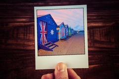 Hand holding polaroid photograph of famous Brighton Beach Boxes. In Melbourne, Australia. Travel memories scrapbooking of good times with copy space royalty free stock images