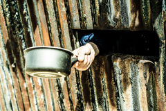 Hand holding a pot, concept of world hunger Royalty Free Stock Photos