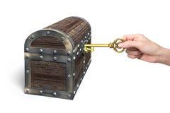 Hand holding pound symbol key open treasure chest. Hand holding pound symbol key to open the treasure chest, isolated on white background Stock Photography