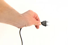 Hand holding a Power Cord Royalty Free Stock Image