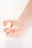 Hand holding prescription bottle Stock Photo