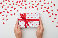 Hand holding present box over flat layout Stock Images