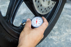 Hand holding pressure gauge Royalty Free Stock Photography