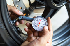 Hand holding pressure gauge Stock Photography